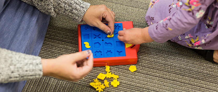 Child Psychologist using play therapy