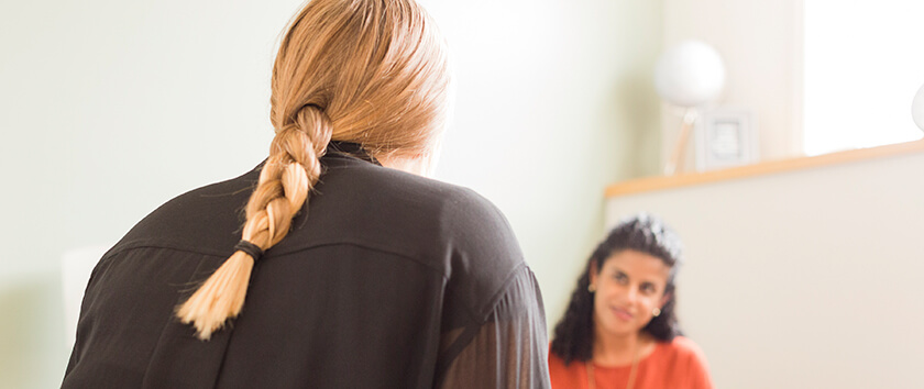 Psychologist speaking with the parent of a teen